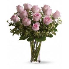 Une douzaine de roses roses