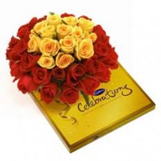 Panier de 20 Roses et boîte de Cadbury Celebration Pack