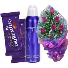 Roses avec un spray corporel pour femmes et du chocolat