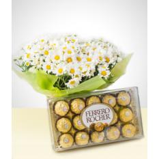 Floraison: bouquet de marguerites et de chocolats