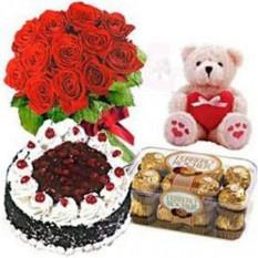 12 bouquet de roses rouges, 16 chocolats Ferrero, 1 Kg Gâteau Forêt Noire et ours en peluche gratuit