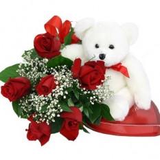 6 roses. Chocolats et ours inclus