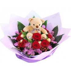 Bear on Flower Bed
